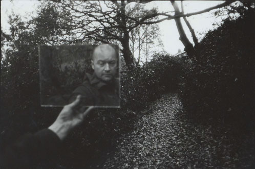 hand held mirror self portrait photograph by photographer julian flynn